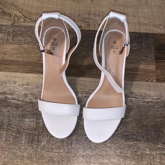Super cute white high heels.